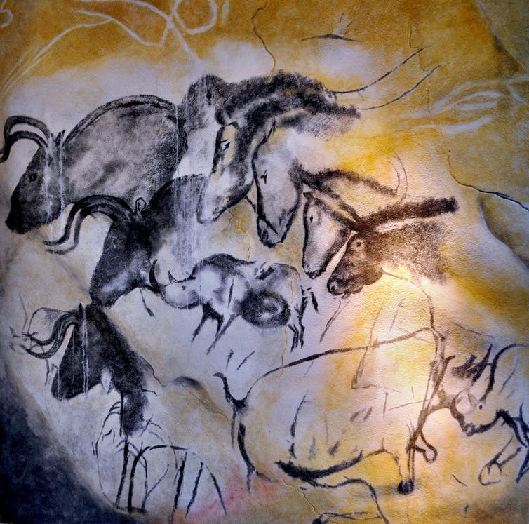 Chauvet cave paintings depicting wild animals including horses.