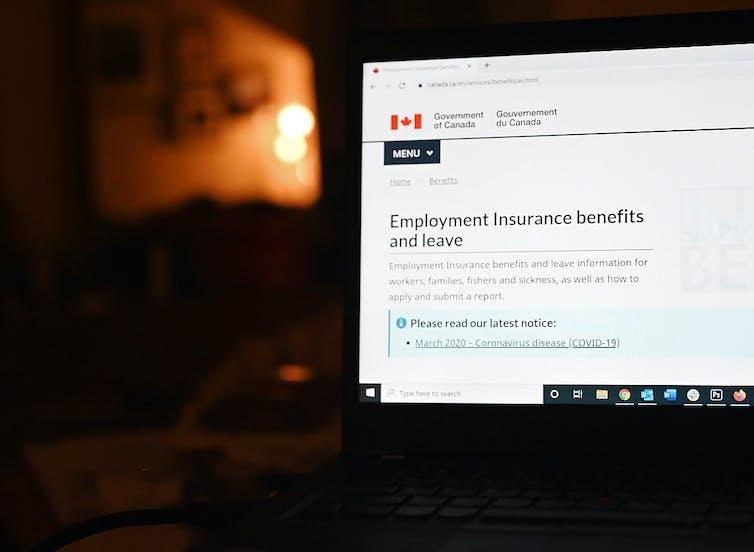 An employment insurance form on a laptop.