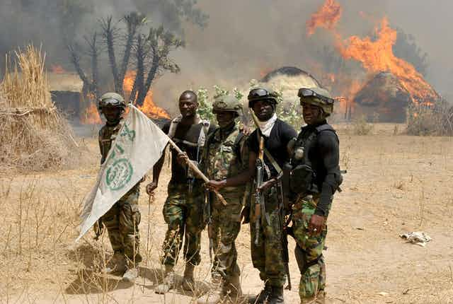 Nigerian soldiers are seen after an operation against Boko Haram terrorists at a terrorist camp in Borno State, Nigeria