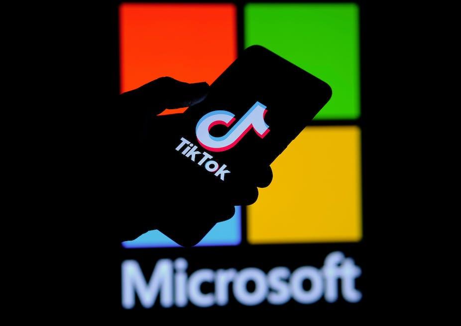TikTok phone screen over Microsoft background