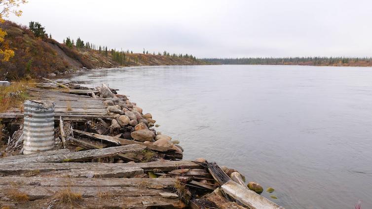 A derelict wharf on a river
