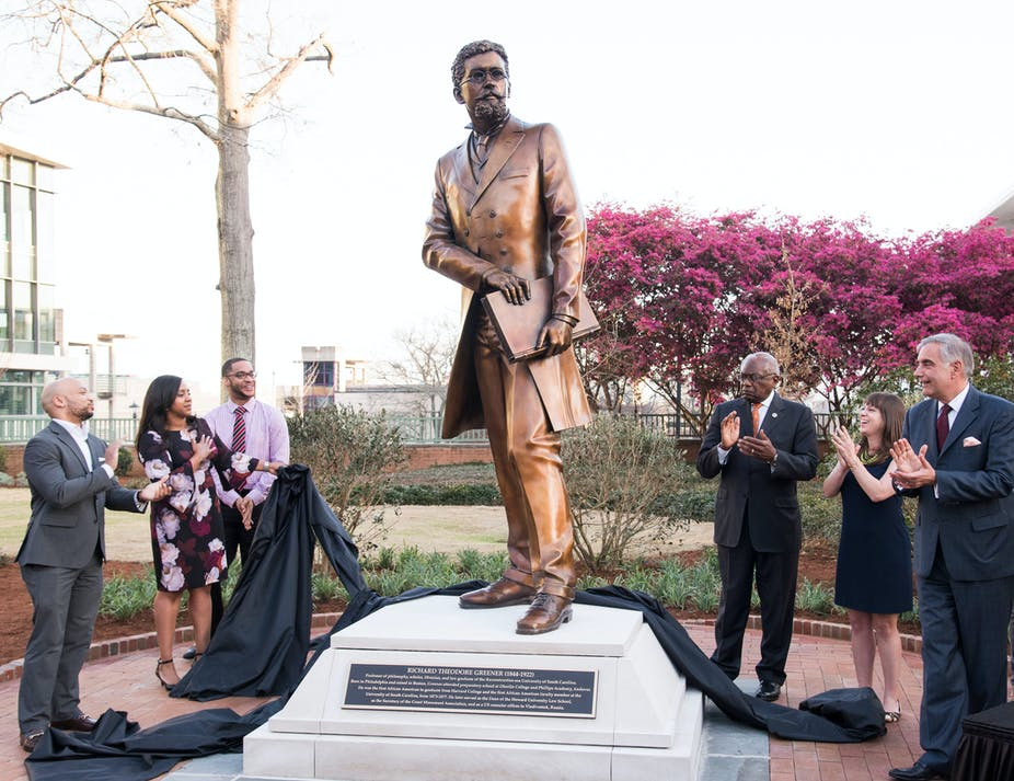 People stand near a statue at the University of South Carolina.