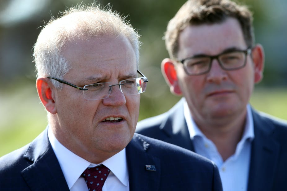 Prime Minister Scott Morrison stands with Victorian Premier Daniel Andrews.