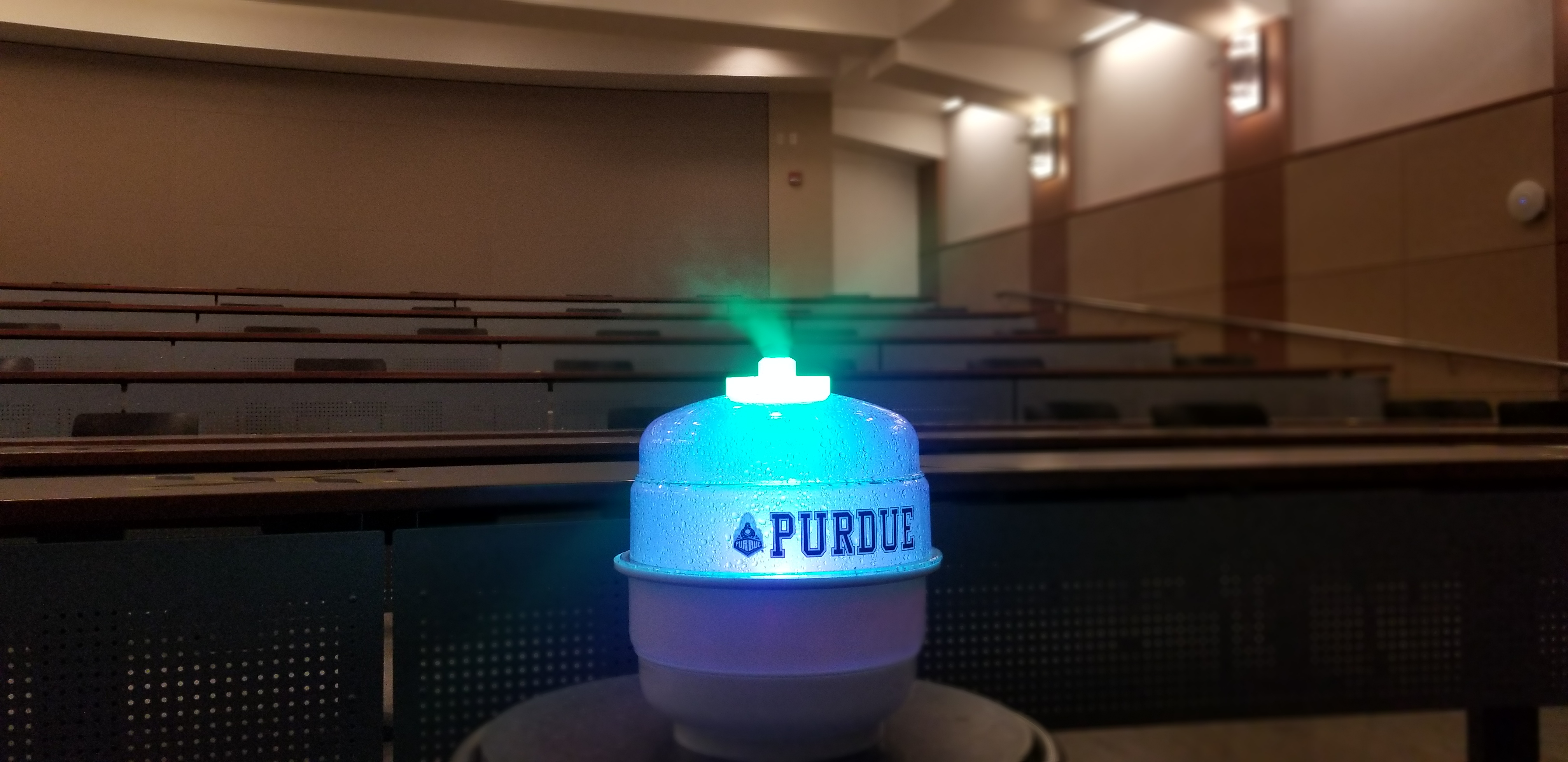A humidification-like device that emits mist in a classroom
