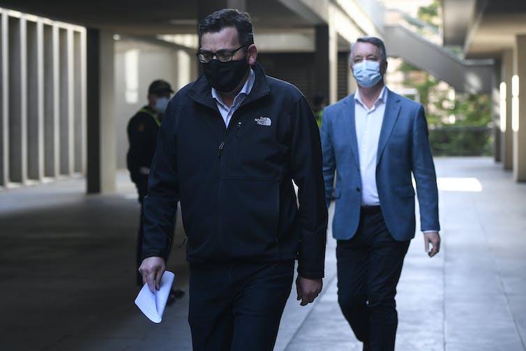 Victorian Premier Daniel Andrews and Mental Health Minister Martin Foley walking and wearing masks