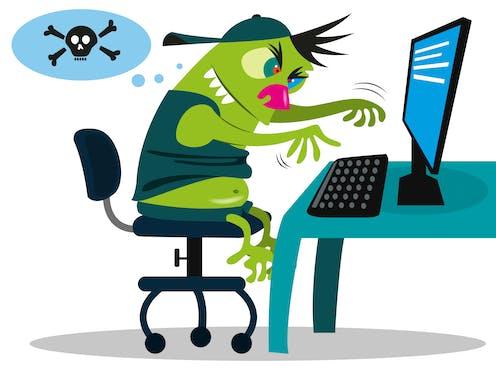 A green troll at a computer keyboard.