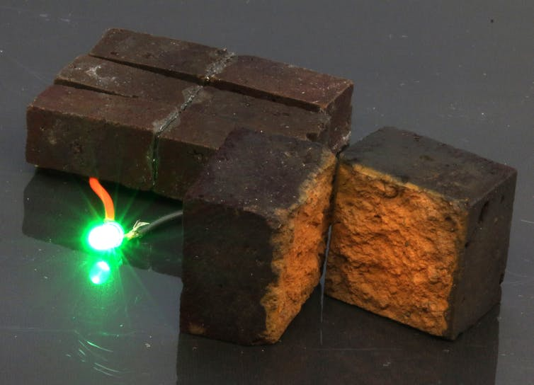 coated brick powering small lightbulb
