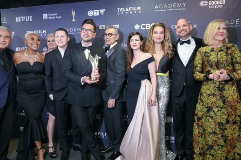 The cast of the sitcom Schitt's Creek posing for a photo at an awards gala.