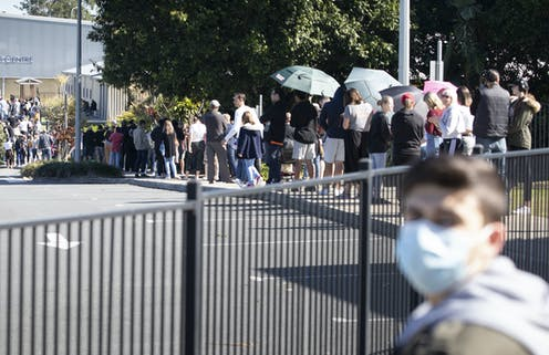 A queue of people waiting to get tested for COVID-19