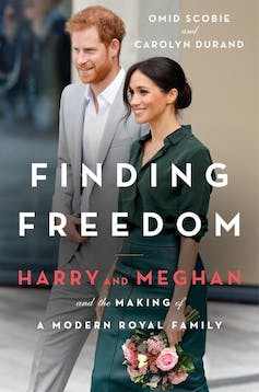 Front cover of 'Finding Freedom', Harry and Meghan smiling for cameras