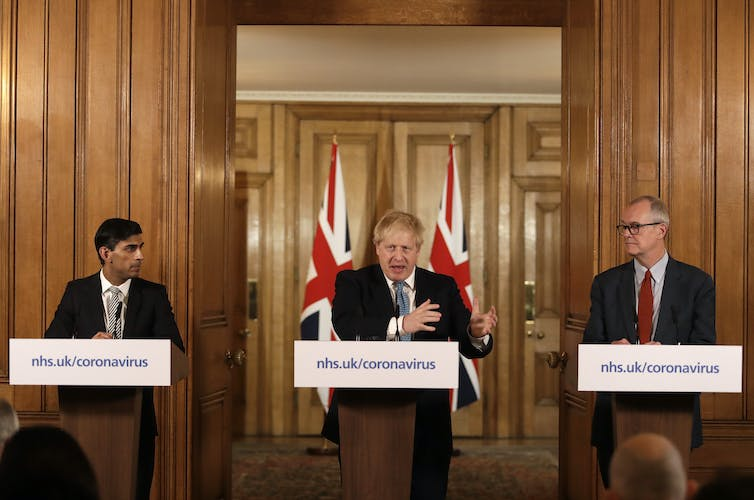 Boris Johnson gives a press briefing on COVID flanked by Rishi Sunak and Patrick Vallance