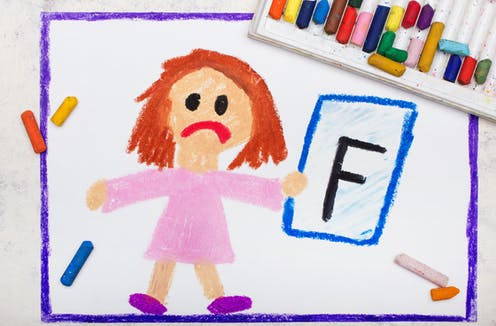 Child's drawing of sad little girl holding up an F grade