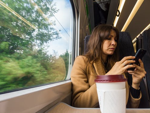 Woman without mask on train