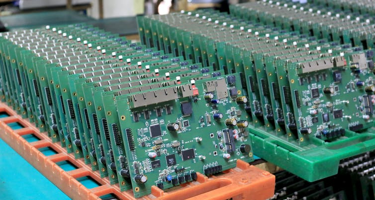 A row of computer circuit boards.