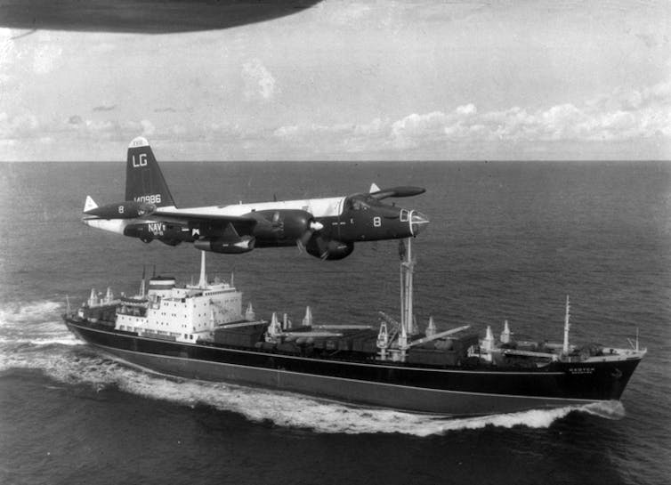 A US aeroplane flying over a Russian boat.