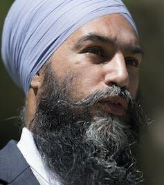 Jagmeet Singh in a pale blue turban.
