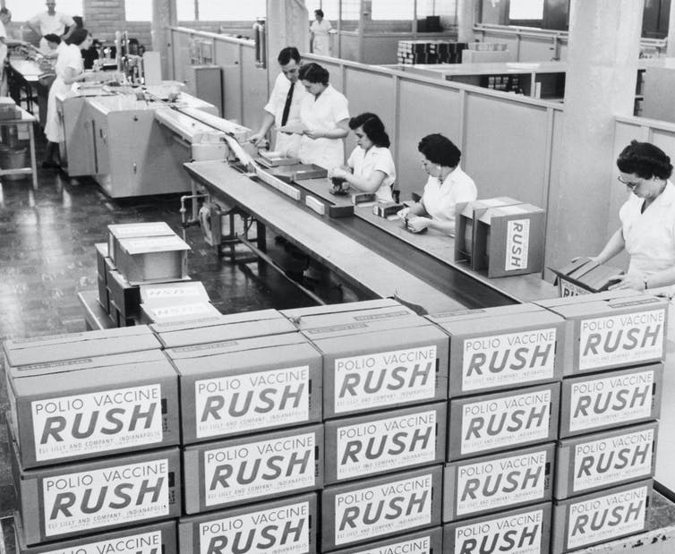archival photo of packing vials of polio vaccine into boxes