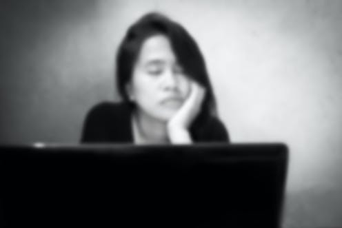 Worried student sitting in front of ptop