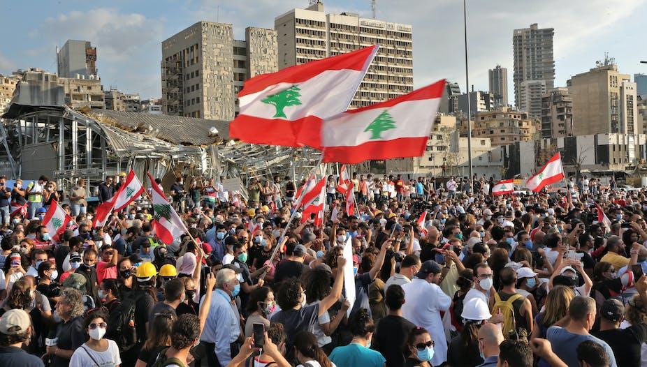 People protesting in Beirut waving Lebanese flag