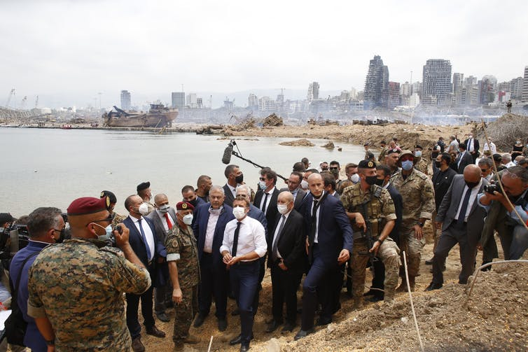 French president Emmanuel Macron in a group of people in Beirut.