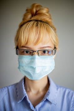 Woman wearing a face mask and eyeglasses