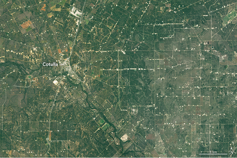 The pads for oil and gas wells are evident in a satellite view of La Salle County, Texas.