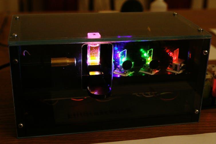 Laboratory equipment containing laser-illuminated tube