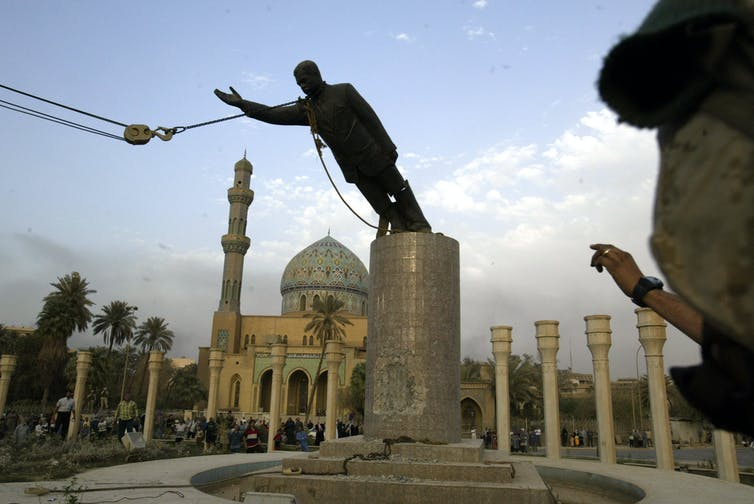 Staute of Saddam Hussein being toppled in 2003.