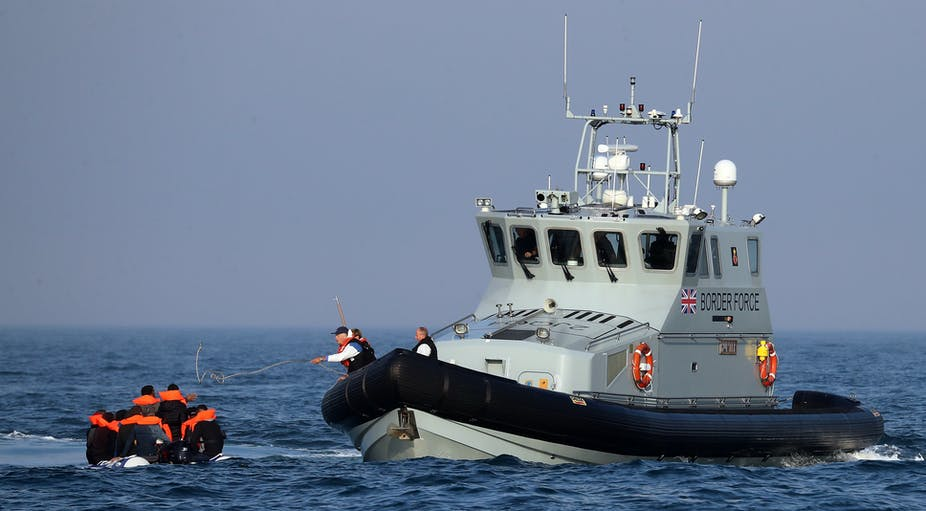 Border Force vessel intercepting dinghy with asylum seekers.