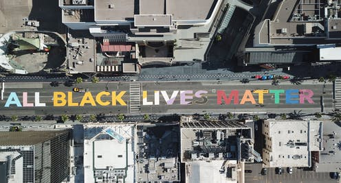 """The words """"All Black Lives Matter"""" are seen painted on Hollywood Boulevard in California."""