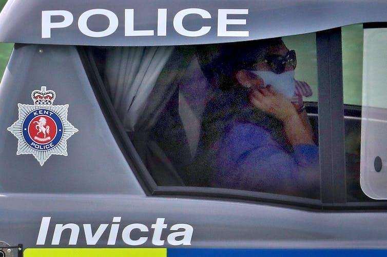 Priti Patel sits in a police boat.