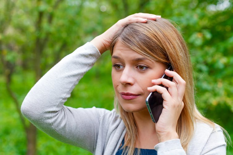 Worried woman using a smartphone