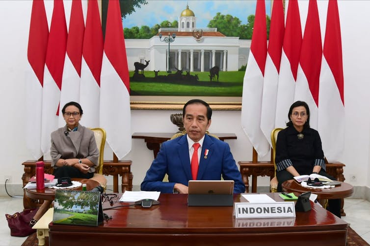 Foreign Minister Retno Marsudi (left) and Finance Minister Sri Mulyani (right) accompany President Joko Widodo at the virtual Group of 20 Summit earlier this year.