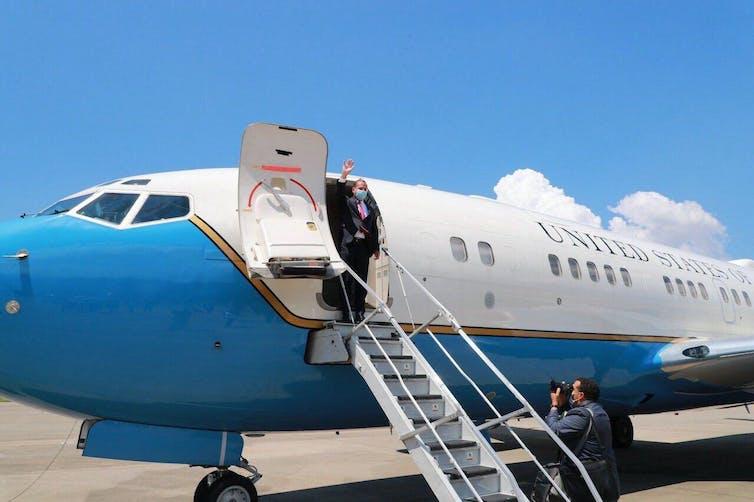 US Health Secretary Alex Azar stepping off plane and waving
