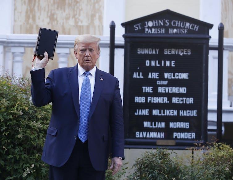 Donald Trump holding a Bible outside a church in Washington DC