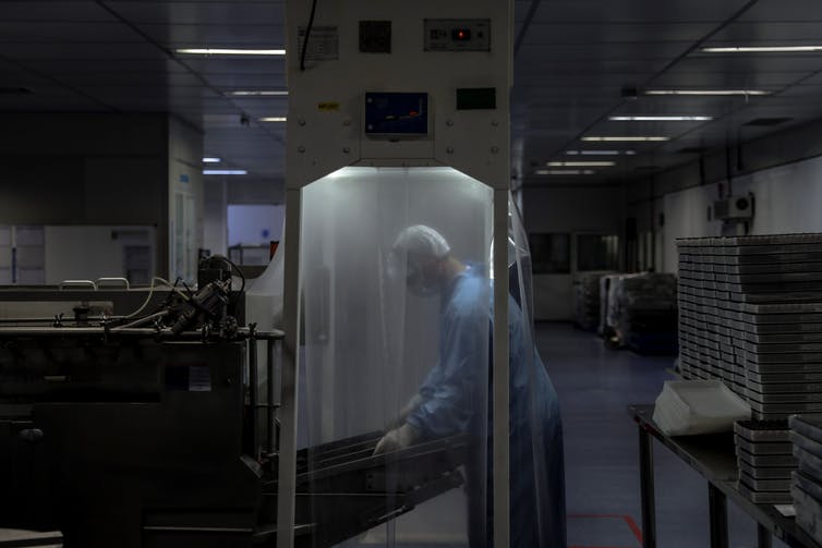 A researcher in a laboratory wearing protective gear