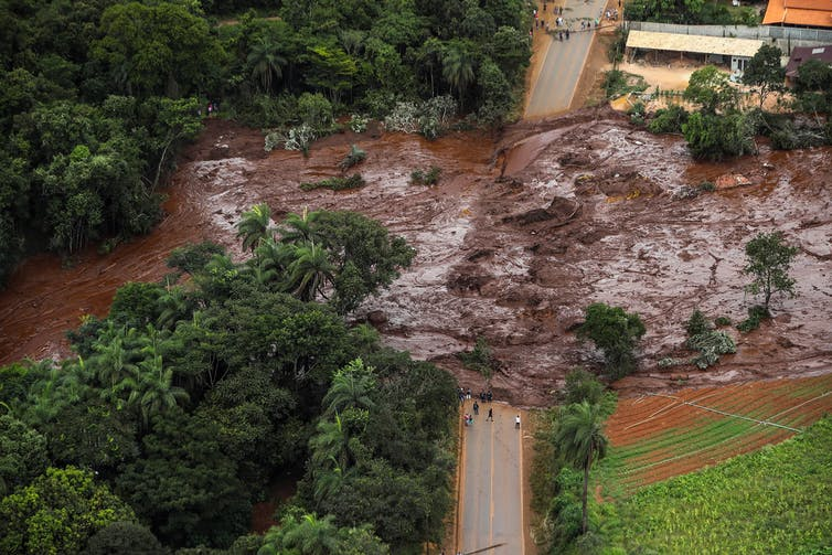 Mud flows over a road in Brazil after a mine accident
