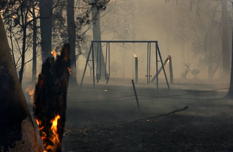 A burnt playground in smoke.