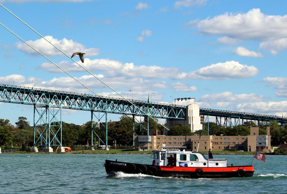 A boat on the Detroit River delivers mail to and from ships.