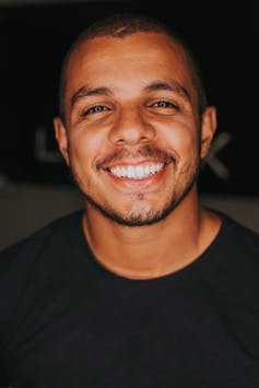 A man with beautiful white teeth smiling broadly.