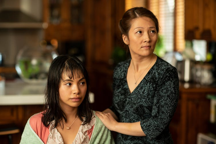 Movie still of two Asian women.
