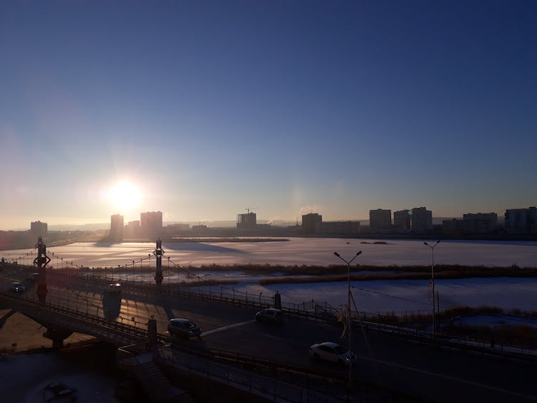 A bridge, buildings and frozen plains.