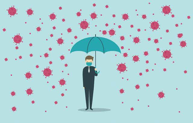 A graphic showing a person wearing a mask and holding umbrella being protected from a rain of coroanvirus