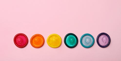 A row of rainbow-coloured condoms