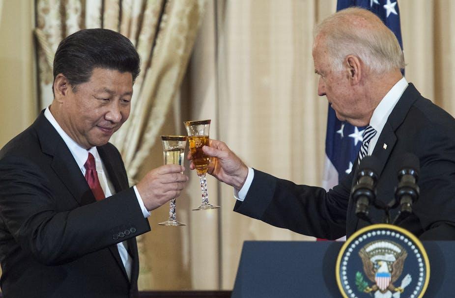Joe Biden and Xi Jinping toast their glasses