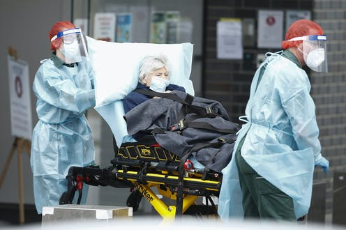 A woman infected with COVID-19 is transferred from an aged care home to hospital.