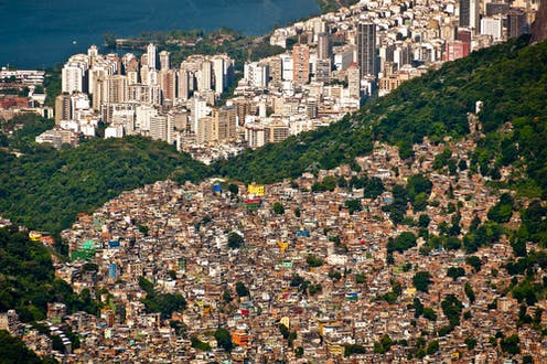 Rio de Janeiro favelas and skyscrapers separated by a forest
