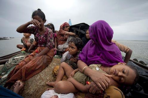 Rohingya women on a boat fleeing from Myanmar