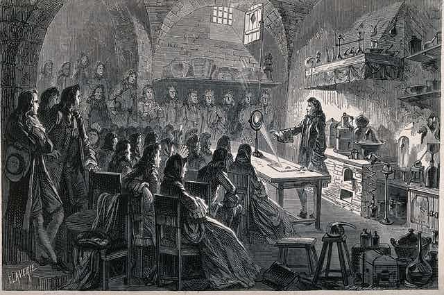 Crowded lecture hall with Isaac Newton performing an experiment.