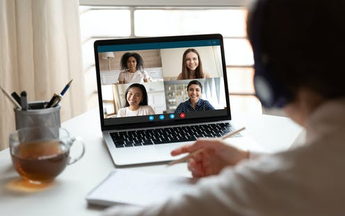 A screenshot of people on a videoconferencing.